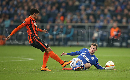 25.02.2016. Gelsenkirchen, Germany. Europa League Round of 32 Second Leg soccer match between Schalke 04 and FC Shakhtar Donetsk in the Veltins Arena in Gelsenkirchen, Germany. Taison (Schachtar Donezk) challenges Leon Goretzka (Schalke)