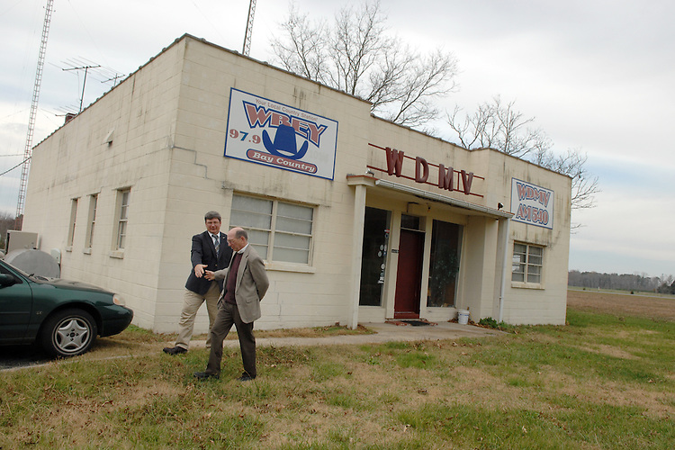 Rep. Wayne Gilchrest, R-MD, right, bids farewell to Mayor Michael McDermott, at WGOP 540 in Pocomoke City, Maryland, after the McDermott interviewed him for a weekly radio show.