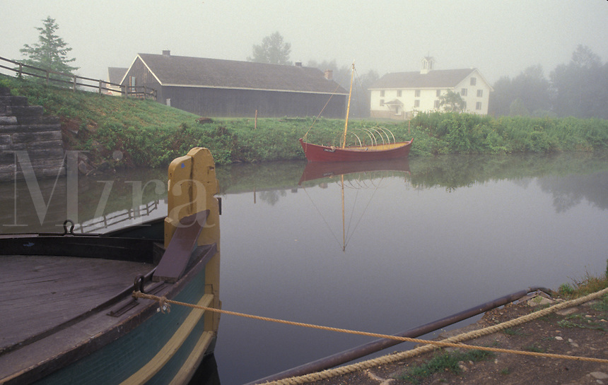 AJ4377, Erie Canal, Erie Canal Village, Rome, New York, Canal boats on the quiet calm water at the Erie Canal Village an 1840 community along the Erie Canal in Rome in the state of New York.