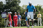 Dwight Yorke kicks a football at the 14th hole during the World Celebrity Pro-Am 2016 Mission Hills China Golf Tournament on 22 October 2016, in Haikou, China. Photo by Weixiang Lim / Power Sport Images