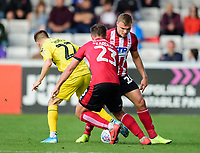 Fleetwood Town's Ashley Hunter is blocked by Lincoln City's Harry Anderson, right, and Neal Eardley<br /> <br /> Photographer Andrew Vaughan/CameraSport<br /> <br /> The EFL Sky Bet League One - Lincoln City v Fleetwood Town - Saturday 31st August 2019 - Sincil Bank - Lincoln<br /> <br /> World Copyright © 2019 CameraSport. All rights reserved. 43 Linden Ave. Countesthorpe. Leicester. England. LE8 5PG - Tel: +44 (0) 116 277 4147 - admin@camerasport.com - www.camerasport.com