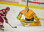19 February 2016: University of Vermont Catamount Goaltender Packy Munson, a Freshman from Hugo, MN, makes a second period save on a breakaway by Boston College Eagle Defenseman Michael Kim, a Freshman from Toronto, Ontario, during play at Gutterson Fieldhouse in Burlington, Vermont. The Eagles defeated the Catamounts 3-1 in the first game of their weekend series. Mandatory Credit: Ed Wolfstein Photo *** RAW (NEF) Image File Available ***