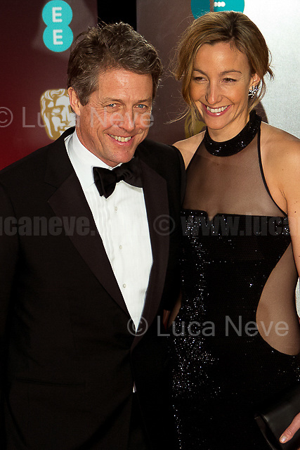Hugh Grant & Anna Elisabet Eberstein.<br /> <br /> London, 12/02/2017. Red Carpet of the 2017 EE BAFTA (British Academy of Film and Television Arts) Awards Ceremony, held at the Royal Albert Hall in London.<br /> <br /> For more information please click here: http://www.bafta.org/