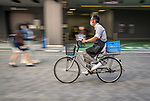 Local bicycling though the back streets of Asakusa, Tokyo, Japan