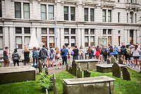 """A large tour group visits the grave of Alexander Hamilton, left,  in Trinity Church's cemetery in the Financial District of New York on Thursday, June 16, 2016. Because of the success of the musical """"Hamilton"""" on Broadway sites associated with him have seen an increase in interest and tourist traffic. (©Richard B. Levine)"""