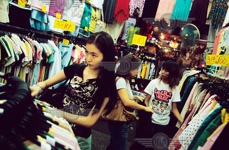 Girls shopping in the Temple Street Night Market in Kowloon....