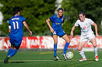 Seattle, WA - Sunday, May 1, 2016: FC Kansas City midfielder Heather O'Reilly (9) works to maintain possession as Seattle Reign FC defender Carson Pickett (16) looks on during a National Women's Soccer League (NWSL) match at Memorial Stadium. Seattle won 1-0.