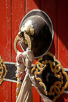 Doorknocker draped with silk khata in Tibet. A khata is a traditional ceremonial scarf and symbolize purity and compassion. They are often presented as gifts on auspicious occasions..