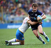17th March 2018, Stadio Olimpico, Rome, Italy; NatWest Six Nations rugby, Italy versus Scotland; Tommaso Allan of Italy challenges Pete Horne of Scotland