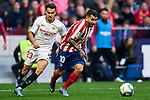 Angel Martin Correa of Atletico de Madrid and Sergio Reguilon of Sevilla during La Liga match between Atletico de Madrid and Sevilla FC at Wanda Metropolitano Stadium in Madrid, Spain. March 07, 2020. (ALTERPHOTOS/A. Perez Meca)
