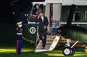 United States President Barack Obama salutes the Marine Guard as he steps off of Marine One on the South Lawn of the White House in Washington, D.C., U.S., on Tuesday, October 9, 2012 The President was returning from a two-day campaign trip to California and Ohio. Photographer: Pete Marovich/Bloomberg.Credit: Pete Marovich / Pool via CNP