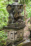 Monkey Forest, Ubud, Bali, Indonesia; a stone elephant statue at the base of a staircase