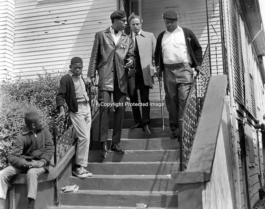 Actor Marlan Brando and Black Panther member visit the house at 1218 28th St.in Oakland, Ca where Panther shootout with Oakland Police occured resulting in the death of young Bobby Hutton.(copyright@1968(<br /> (1968 photo/Ron Riesterer)
