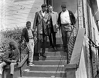 Actor Marlan Brando and Black Panther member visit the house at 1218 28th St.in Oakland, Ca where Panther shootout with Oakland Police occured resulting in the death of young Bobby Hutton.(copyright@1968(<br />