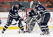 Trevor van Riemsdyk (UNH - 6), Matt Di Girolamo (UNH - 30), Connor Hardowa (UNH - 2) - The Harvard University Crimson defeated the University of New Hampshire Wildcats 7-6 on Tuesday, November 22, 2011, at Bright Hockey Center in Cambridge, Massachusetts.