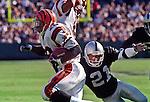 Oakland Raiders vs. Cincinnati Bengals at Oakland Alameda County Coliseum Sunday, October 25, 1998.  Raiders beat Bengals 27-10.  Cincinnati Bengals running back Corey Dillon (28) runs past Oakland Raiders defensive back Eric Allen (21).