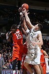 28 February 2016: Wake Forest's Konstantinos Mitoglou (GRE) (44) and Devin Thomas (2) challenge for a rebound against Virginia Tech's Chris Clarke (15). The Wake Forest University Demon Deacons hosted the Virginia Tech Hokies at Lawrence Joel Veterans Memorial Coliseum in Winston-Salem, North Carolina in a 2015-16 NCAA Division I Men's Basketball game. Virginia Tech won the game 81-74.