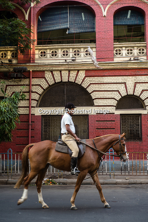 The cavalry division of the Kolkata police patrols the streets of New Market area in Kolkata, West Bengal  on Friday, May 26, 2017. Photographer: Sanjit Das