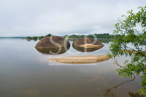 Pará State, Brazil. Xingu River. Two rounded rocks and a sandy beach making a smiley face.