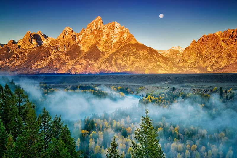 Full moonrise with fog, fall color, Snake River, and Teton Mountains.  Grand Teton National Park, WY