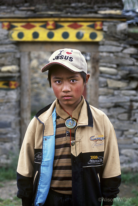 Boy in Jesus hat, Tagong, Kham, Eastern Tibet, 2005
