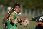 Nau Tapui gets his pass away after drawing 2 Pukekohe defnders to him. Counties Manukau Premier Club rugby game between Drury & Pukekohe played at the Drury Domain on Saturday May 23rd 2009..Pukekohe won the game 23 - 11 after laeding 16 - 11 at halftime.