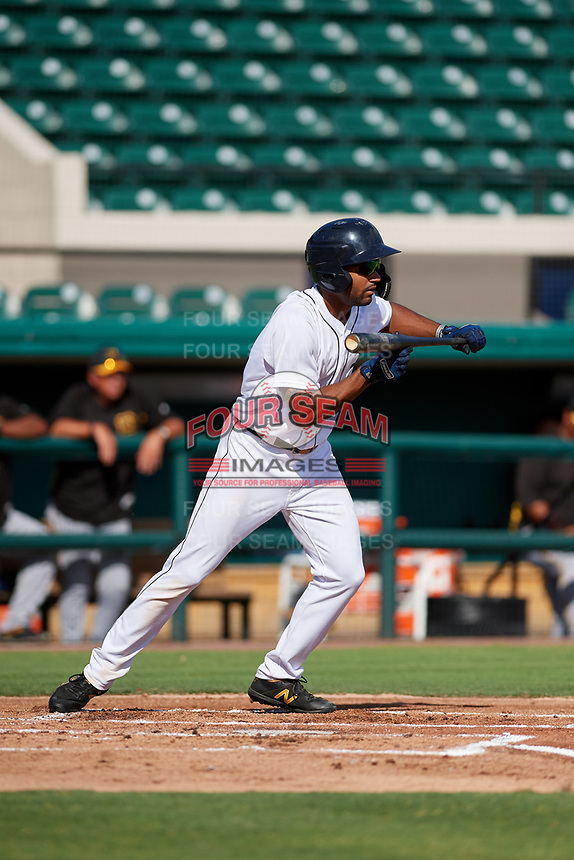 Detroit Tigers Derek Hill (31) squares around to bunt during a Florida Instructional League game against the Pittsburgh Pirates on October 6, 2018 at Joker Marchant Stadium in Lakeland, Florida.  (Mike Janes/Four Seam Images)