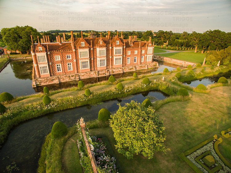 Helmingham Hall is a moated manor house in Helmingham, Suffolk, England. It was begun by John Tollemache in 1480 and has been owned by the Tollemache family ever since. The house is built around a courtyard in typical late medieval/Tudor style