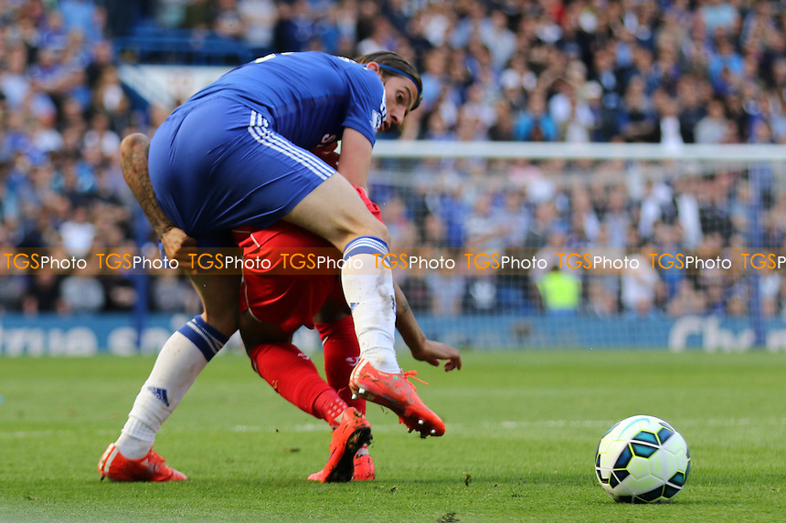 Filipe Luis of Chelsea tries to reach the ball in spite of Liverpool's Raheem Sterling attempt to stop him - Chelsea vs Liverpool - Barclays Premier League Football at Stamford Bridge, London - 10/05/15 - MANDATORY CREDIT: Paul Dennis/TGSPHOTO - Self billing applies where appropriate - contact@tgsphoto.co.uk - NO UNPAID USE