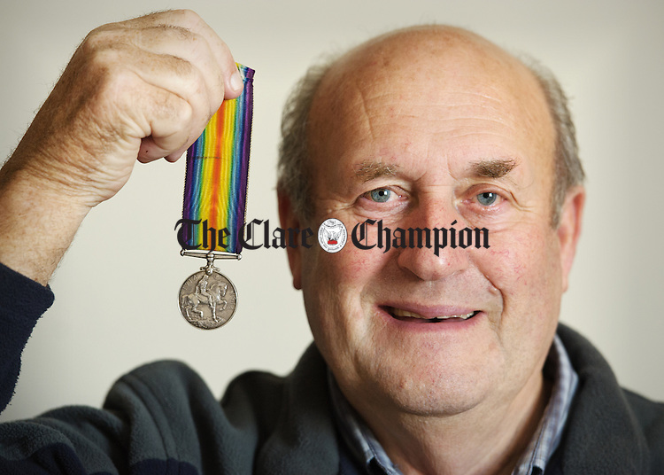 Pat Hynes, originally from Kilnoe, Bodyke, and living on the Clare Road in Ennis, with the World War One medal for which he is trying to find any  living relatives of the original owner. Photograph by John Kelly.
