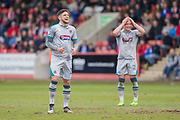 Danny Andrew and Ben Davies of Grimsby react after Andrew strikes a free kick off target during the Sky Bet League 2 match between Cheltenham Town and Grimsby Town at the The LCI Rail Stadium,  Cheltenham, England on 17 April 2017. Photo by PRiME Media Images / Mark Hawkins.