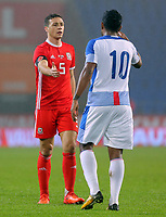 (L-R) James Chester of Wales greets Ricardo Buitrago of Panama at the end of the game during the international friendly soccer match between Wales and Panama at Cardiff City Stadium, Cardiff, Wales, UK. Tuesday 14 November 2017.