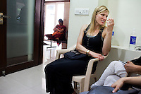 American Jennifer (center, blond), 38, chats with other surrogacy clients as they wait in the Akanksha Infertility Clinic in the small town of Anand, Gujarat, India. Jennifer wants to try surrogacy after 5 unexplained failed pregnancies, &quot;I would go and pick a baby up from the street, which I wouldn't really but that's the kind of desperation that comes from infertility.&quot;.<br /> The Akanksha Infertility Clinic is known internationally for its surrogacy program and currently has over a hundred surrogate mothers pregnant in their environmentally controlled surrogate houses. <br /> Photo by Suzanne Lee for Panos London