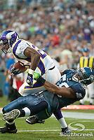Seattle Seahawks linebacker Leroy Hill (56) tackles Minnesota Vikings running back Adrian Peterson (28) near the goal line at CenturyLink Field in Seattle, Washington.
