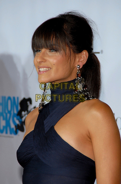 NELLY FURTARDO.Conde Nast Media Group's Third Annual Fashion Rocks Concert at Radio City Music Hall, New York, NY, USA,.7 September 2006..portrait headshot fringe naby blue halterneck dress disc earrings dangly.Ref: ADM/PH.www.capitalpictures.com.sales@capitalpictures.com.©Paul Hawthorne/AdMedia/Capital Pictures. *** Local Caption ***