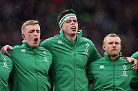 James Ryan, Dan Leavy and Keith Earls of Ireland sing their national anthem. Natwest 6 Nations match between England and Ireland on March 17, 2018 at Twickenham Stadium in London, England. Photo by: Patrick Khachfe / Onside Images