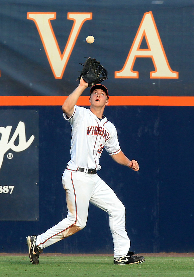 Virginia outfielder Joe McCarthy (31) catches the ball for an out during the game Tuesday night against VCU at Davenport Stadium in Charlottesville, VA. Photo/The Daily Progress/Andrew Shurtleff