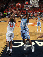 North Carolina forward Kennedy Meeks (3) grabs a rebound next to Virginia guard Malcolm Brogdon (15) during an NCAA basketball game against Virginia Monday Jan. 20, 2014 in Charlottesville, VA. Virginia defeated North Carolina 76-61.