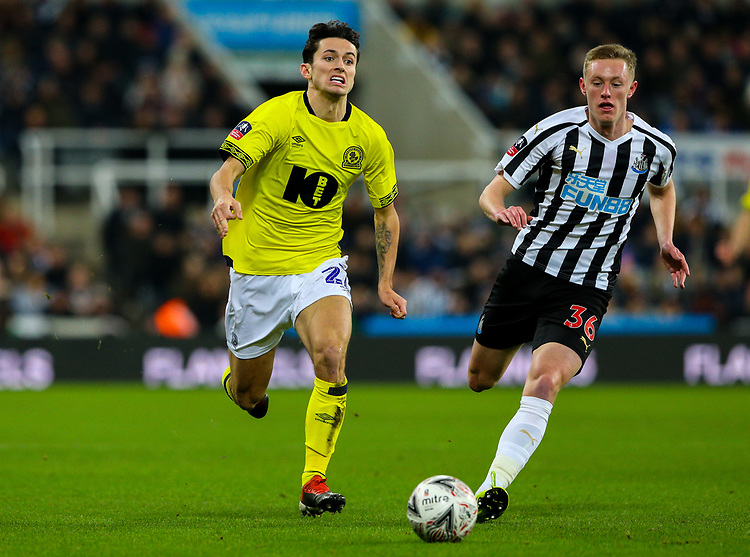 Blackburn Rovers' Lewis Travis takes on Newcastle United's Sean Longstaff<br /> <br /> Photographer Alex Dodd/CameraSport<br /> <br /> Emirates FA Cup Third Round - Newcastle United v Blackburn Rovers - Saturday 5th January 2019 - St James' Park - Newcastle<br />  <br /> World Copyright © 2019 CameraSport. All rights reserved. 43 Linden Ave. Countesthorpe. Leicester. England. LE8 5PG - Tel: +44 (0) 116 277 4147 - admin@camerasport.com - www.camerasport.com