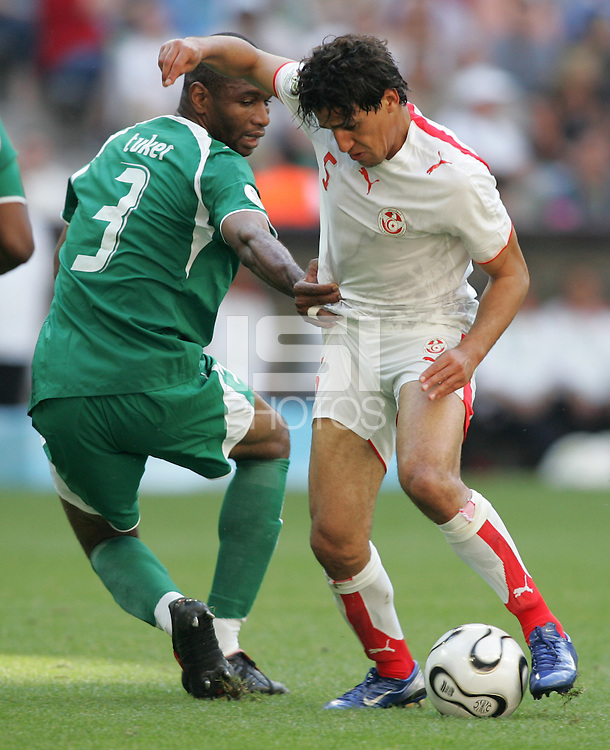 Tunisian forward (5) Zied Jaziri slips past Saudi Arabian defender (3) Karim Haggui. Saudi Arabia and Tunisia played to a 2-2 tie in their FIFA World Cup Group H match at FIFA World Cup Stadium, Munich, Germany, June 14, 2006.