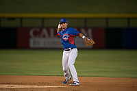 AZL Cubs 2 second baseman Reivaj Garcia (24) throws to first base during an Arizona League game against the AZL Rangers at Sloan Park on July 7, 2018 in Mesa, Arizona. AZL Rangers defeated AZL Cubs 2 11-2. (Zachary Lucy/Four Seam Images)