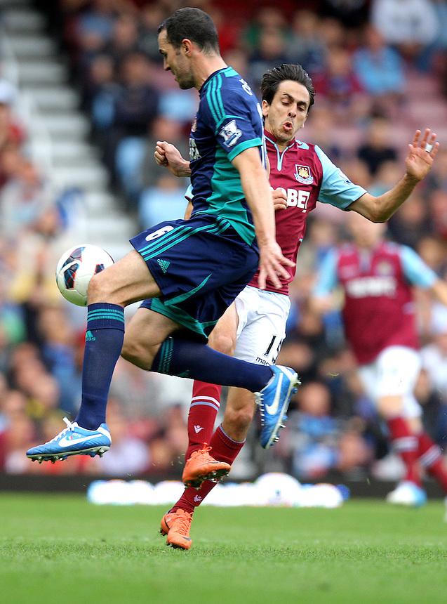 Sunderland's Lee Cattermole battles with West Ham's Yossi Benayoun..Football - Barclays Premiership - West Ham United v Sunderland - Saturday 22nd September 2012 - Boleyn Ground - London..