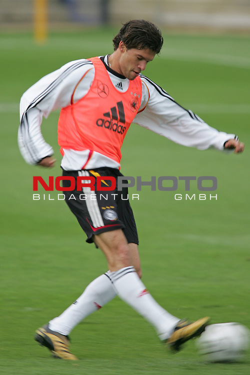 FIFA WM 2006 - Training - Germany<br /> Midfielder Michael Ballack kicks a ball during a training session at the World Cup in Berlin. <br /> Foto &copy; nordphoto