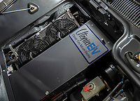 BNPS.co.uk (01202 558833)<br /> Pic: PhilYeomans/BNPS<br /> <br /> Tesla batteries and software heve been placed in the engine bay and under the bonnet.<br /> <br /> Back to the Future...finally!<br /> <br /> A British car nut has spent over £200,000 converting his DeLorean into a stunning electric eco supercar for the 21st century.<br /> <br /> The transformation of the lame duck motor from the 1980's using Tesla battery technology brings the ill fated model right back to the future.<br /> <br /> Former music producer Phil Wainman commissioned engineer Clint Townsend to attempt to convert the Delorean using Tesla batteries as an eco experiment.<br /> <br /> And the spectacular stainless steel supercar even boasts a Flux Capacitor style gear selector and a sampled annoucement of  'Great Scot' as the powerful motor goes past 88mph.