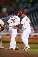 Springfield Cardinals manager Dann Bilardello (11) makes a pitching change as pitcher Iden Nazario (39) leaves the game during a game against the Frisco RoughRiders  on June 4, 2015 at Hammons Field in Springfield, Missouri.  Frisco defeated Springfield 8-7.  (Mike Janes/Four Seam Images)