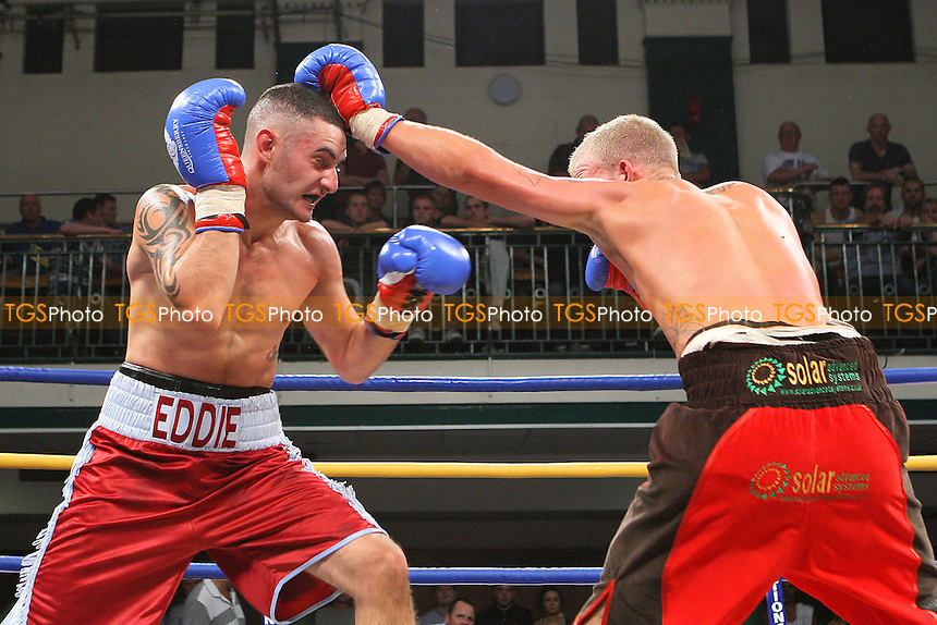 Ediz Hussein (claret/blue shorts) defeats Robin Deakin (red/black shorts) in a Lightweight Boxing Contest at York Hall, Bethnal Green, promoted by Queensberry Promotions - 30/09/11 - MANDATORY CREDIT: Gavin Ellis/TGSPHOTO - Self billing applies where appropriate - 0845 094 6026 - contact@tgsphoto.co.uk - NO UNPAID USE.