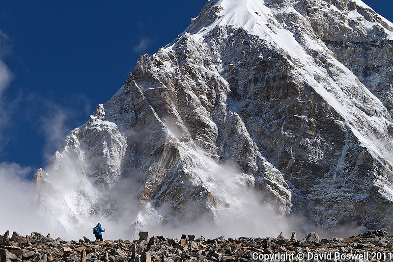 A trekker on Kala Patthar with Pumo Ri in the background.