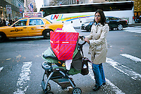 A shopper with her purchases on Fifth Avenue in New York on Thanksgiving,  Thursday, November 24, 2011. Many retailers are opening their doors on Thanksgiving or opening up for Black Friday the night before. (© Richard B. Levine)