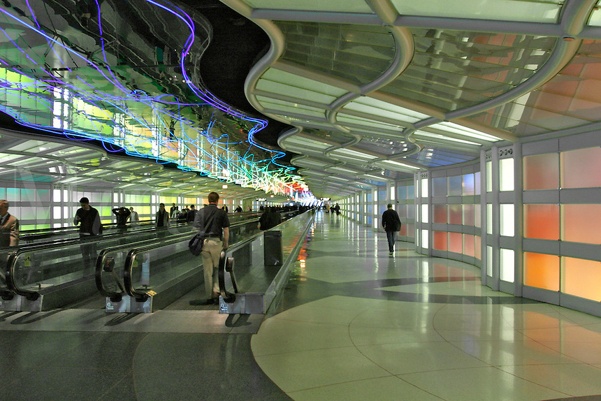 O'Hare International Airport Chicago Illonois.  An esculator transports pasengers to their airplanes. Neon light artwork.