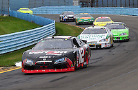 Aug. 8, 2009; Watkins Glen, NY, USA; NASCAR Nationwide Series driver Justin Allgaier (12) leads Kenny Wallace (28) during the Zippo 200 at Watkins Glen International. Mandatory Credit: Mark J. Rebilas-
